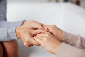 family-holding-hands-e1549562673254