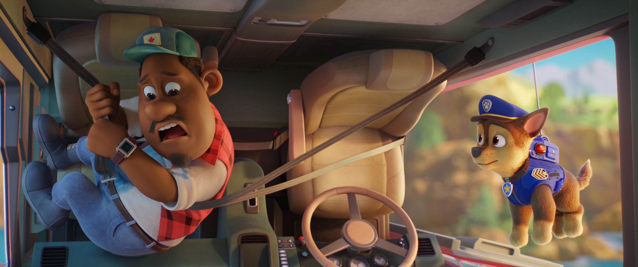 Gus (voiced by Tyler Perry) and Chase (voiced by Iain Armitage) in PAW PATROL: THE MOVIE from Paramount Pictures. Photo Credit: Courtesy of Spin Master.